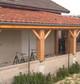 Entreprise construction bois dans l'Est de la France : véranda en charpente traditionnelle dans la Marne - Martin charpentes