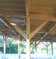 Entreprise construction bois Est de la France : préau d'une école en charpente traditionnelle - Martin charpentes