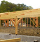 Entreprise construction charpente traditionnelle dans l'Est de la France – Auvent monopente dans la Meuse - Martin charpentes