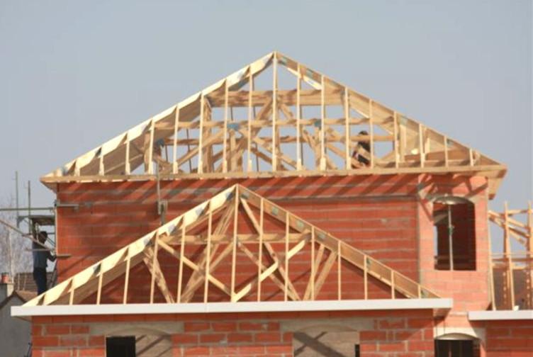 Entreprise construction charpente bois en Lorraine : maison avec charpente industrielle – Martin charpentes