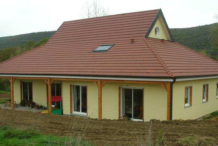 Maison ossature bois avec bardage vanille