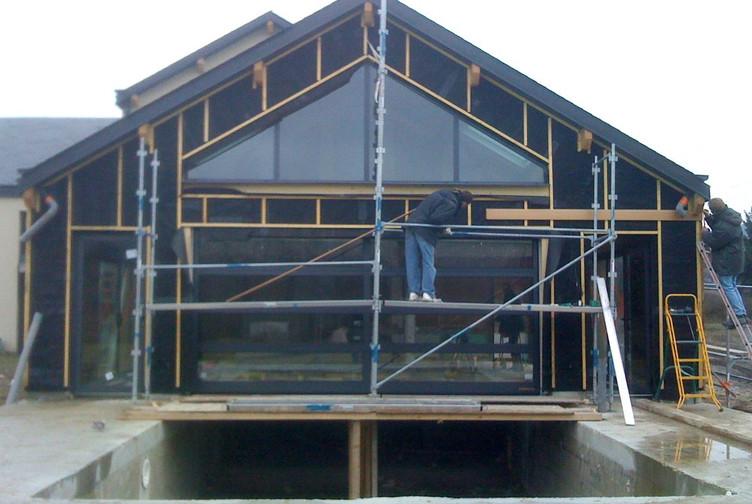Entreprise construction maison en bois : extension ossature bois, piscine semi-couverte, Marne - Martin charpentes